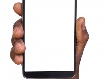 Hand holding smart phone with blank screen